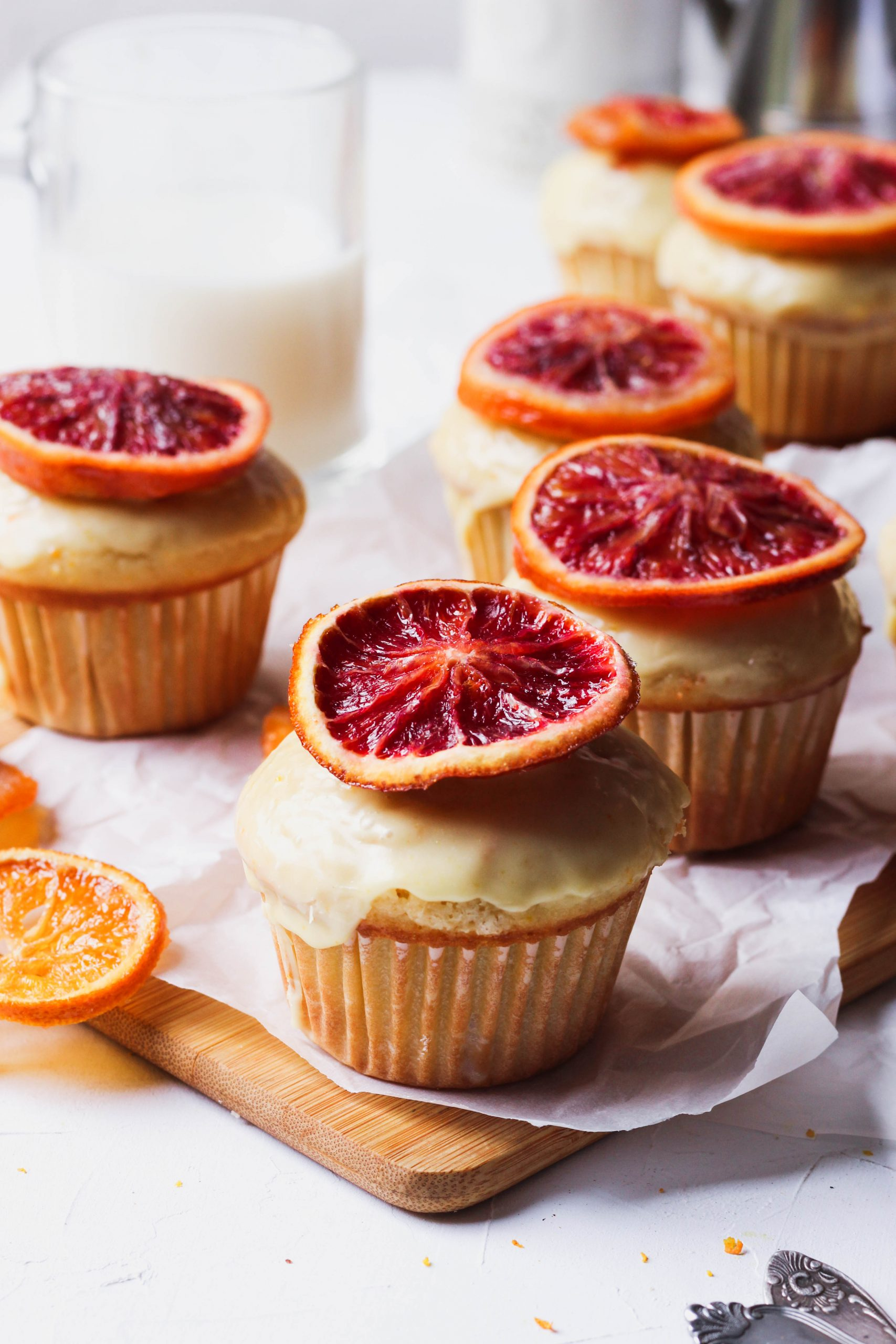 Fluffy orange muffins with a fruity orange glaze and topped with candied blood oranges