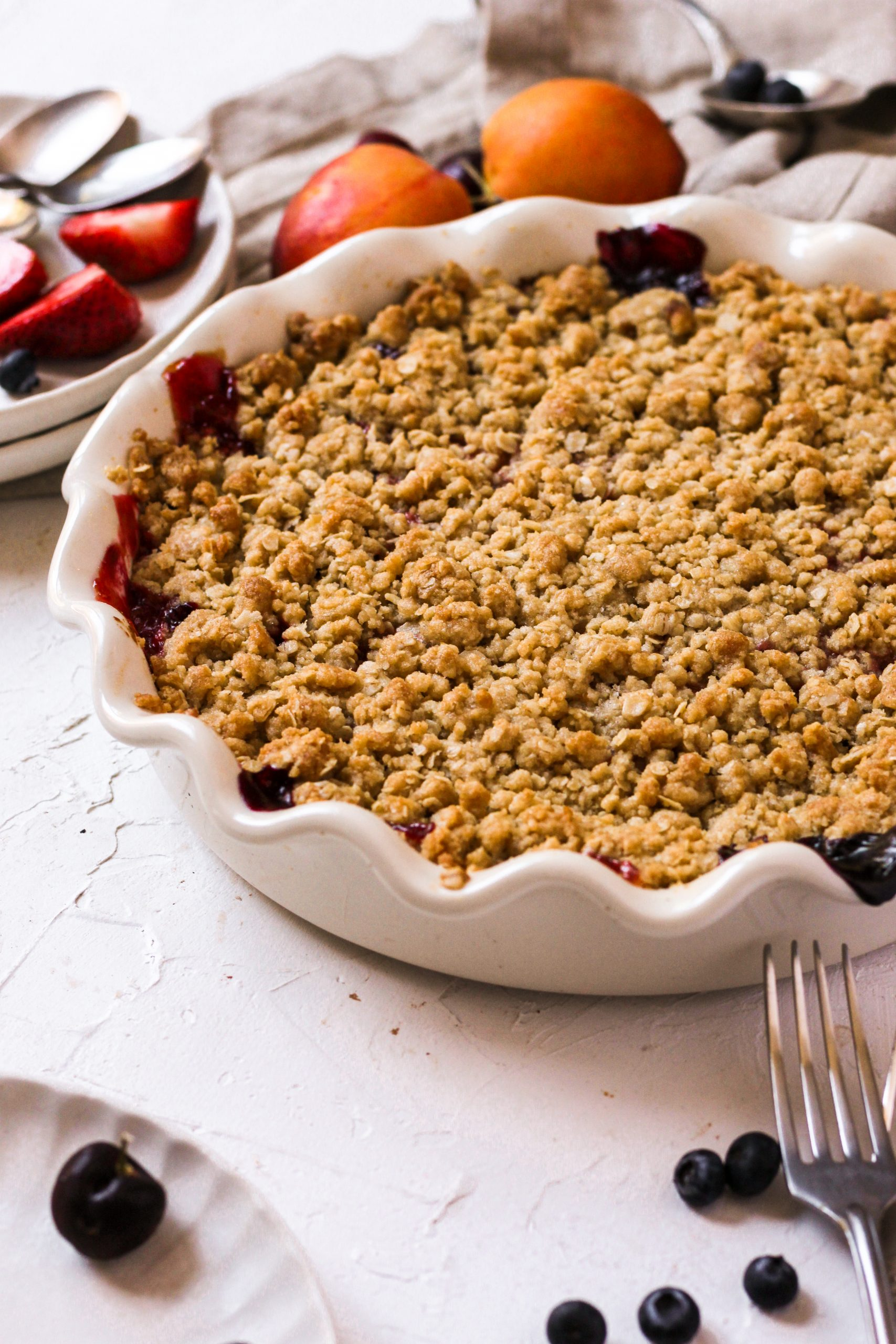 stone fruit and berry crisp with nectarines cherries and berries and oatmeal crispy top