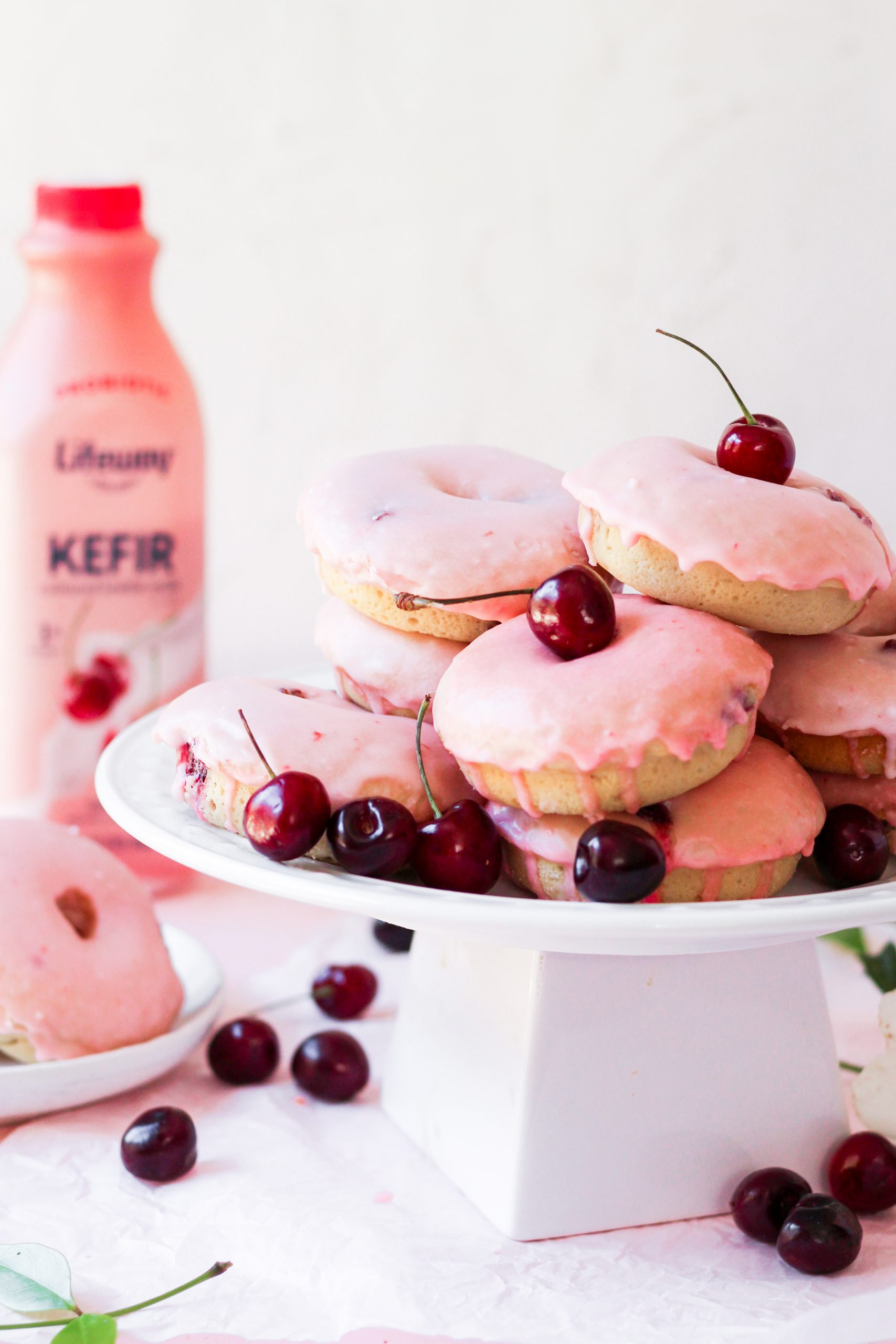 pink glazed baked cherry donuts